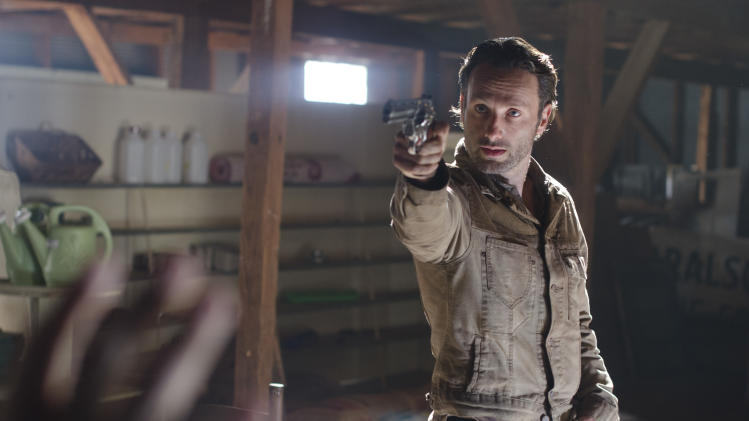 "This image released by AMC shows Andrew Lincoln in a scene from ""The Walking Dead."" (AP Photo/AMC, Gene Page)"