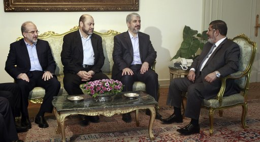 Egypt's president Mursi meets with Hamas leader Meshaal and deputy politburo head Mousa Abu Marzook and Hamas's political bureau Sami Khater in Cairo