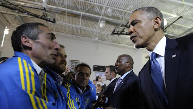 """President Barack Obama meets with Boston Athletic Association volunteers after attend the """"Healing Our City: An Interfaith Service"""" at the Cathedral of the Holy Cross in Boston, Thursday, April 18, 2013, for victims of Monday's Boston Marathon explosions.(AP Photo/Susan Walsh)"""