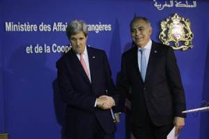 U.S. Secretary of State Kerry shakes hands with Moroccan Foreign Minister Mezouar at news conference following bilateral strategic dialogue at the Foreign Ministry in Rabat