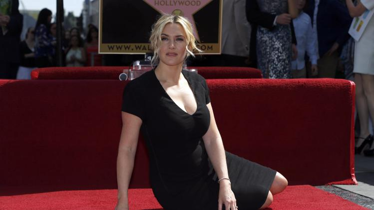 Actress Winslet poses on her star after it was unveiled on the Walk of Fame in Hollywood