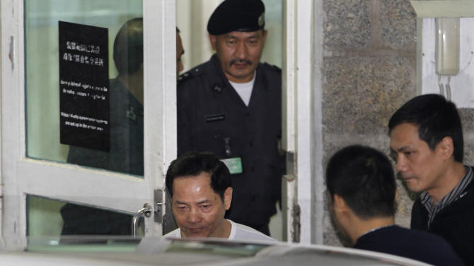Macau crime boss Wan Kuok-koi known as Broken Tooth Koi walks out of Coloane Prison in Macau, China Saturday, Dec. 1, 2012, after serving nearly 15 years. Wan was convicted of loan sharking, money laundering and being a gang leader in November 1999, a month before Portugal handed control of Macau, its colony for more than four centuries, back to Beijing and long before the sleepy enclave welcomed international operators to build the modern resorts that have made it a gambling mecca.   (AP Photo/Vincent Yu)