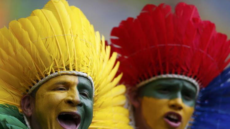 Fans wait for the start of the 2014 World Cup Group A soccer match between Brazil and Cameroon at the Brasilia national stadium in Brasilia