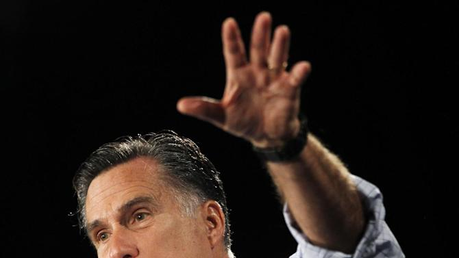 """In this photo taken Aug. 8, 2012, Republican presidential candidate, former Massachusetts Gov. Mitt Romney campaigns in Des Moines, Iowa. Welfare is causing a ruckus in the presidential campaign, but the program is a shadow of its old self in the 1970s, when Ronald Reagan used the image of """"welfare queens"""" against government poverty programs promoted by liberals.  (AP Photo/Charles Dharapak)"""