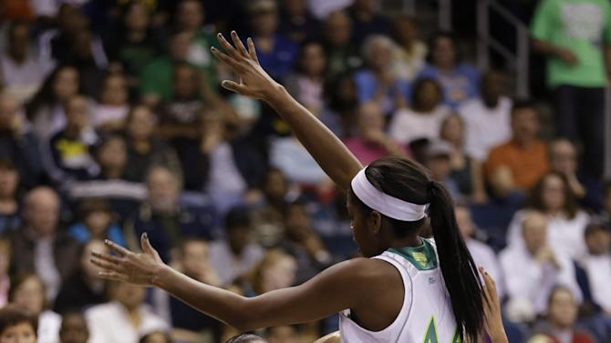 Kansas guard Angel Goodrich, left, is pressured by Notre Dame forward Ariel Braker (44) and guard Jewell Loyd, back,  during the first half of a regional semi-final of the NCAA college basketball tournament  Sunday March 31, 2013, in Norfolk, Va.  (AP Photo/Steve Helber)