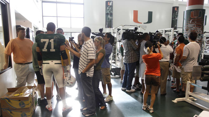 The media talks to Miami football players, including Anthony Chickillo (71) , before practice Thursday, Aug. 25, 2011 in Coral Gables, Fla. (AP Photo/J Pat Carter)