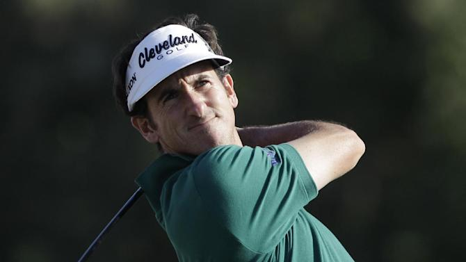 Spain's Gonzalo Fdez-Castano follows his ball on the 16th hole during the third round of Abu Dhabi Golf Championship in Abu Dhabi, United Arab Emirates, Saturday, Jan. 19, 2013. (AP Photo/Kamran Jebreili)