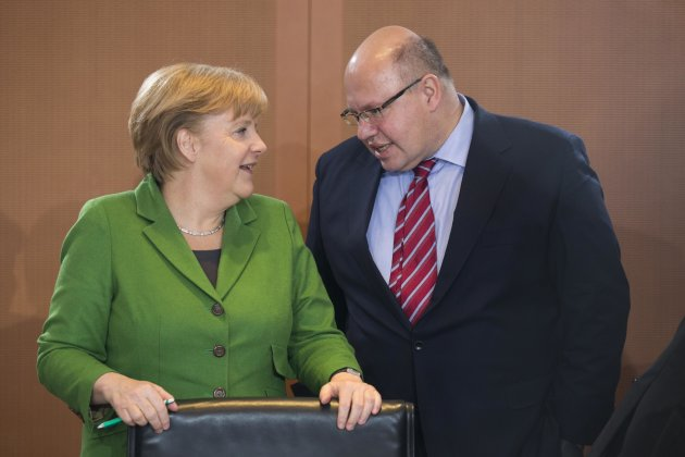 File photo of German Chancellor Merkel talking with Environment Minister Altmaier