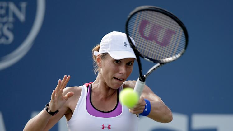 Varvara Lepchenko of the USA returns a shot to Caroline Garcia of France during Day 1 of the Bank of the West Classic at the Taube Family Tennis Stadium on July 28, 2014 in Stanford, California