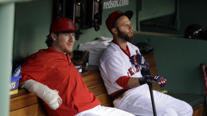 Boston Red Sox catcher Ryan Hanigan sits with his hand in a cast next to teammate Dustin Pedroia in the dugout before a baseball game against the Tampa Bay Rays at Fenway Park in Boston, Tuesday, May 5, 2015. Hanigan underwent surgery after fracturing his right pinkie during a game last Friday. Sox manager John Farrell said the catcher isn't expected to return before the All-Star break. (AP Photo/Elise Amendola)
