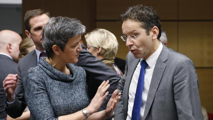 Danish Economy Minister Vestager talks to Dutch Finance Minister Dijsselbloem during a EU finance ministers meeting in Brussels
