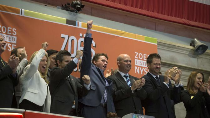Zoe's Kitchen President and CEO Miles celebrates his company's IPO as he rings the opening bell at the New York Stock Exchange