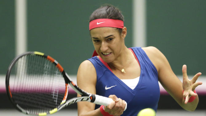Caroline Garcia from France returns a ball to Petra Kvitova from Czech Republic during the Fed Cup  semifinal tennis match in Ostrava, Czech Republic, Sunday, April 19, 2015.  (AP Photo/Petr David Josek)