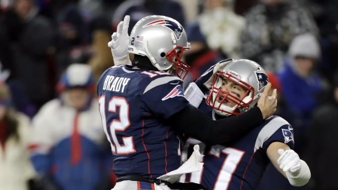 New England Patriots quarterback Tom Brady (12) celebrates his touchdown pass to tight end Rob Gronkowski (87) during the fourth quarter of an NFL football game in Foxborough, Mass., Sunday, Dec. 30, 2012. Gronkowski was active after missing five games with a broken left forearm. (AP Photo/Charles Krupa)