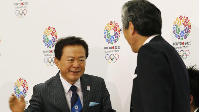 Tokyo Gov. Naoki Inose, left, shakes hands with Tokyo 2020 Olympic Bid Committee President Tsunekazu Takeda, during a press conference, following the International Olympic Committee's evaluation report on the 2020 Olympic bids, in Tokyo, Tuesday, June 25, 2013. Less than three months before the IOC vote, Tokyo received the most praise in a technical assessment of the three cities bidding for the 2020 Olympics on Tuesday. (AP Photo/Koji Sasahara)