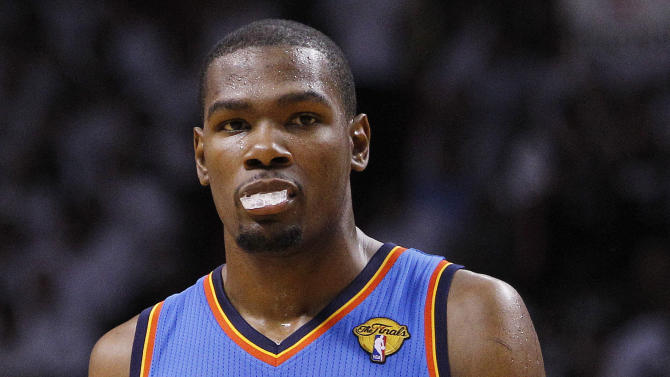 Oklahoma City Thunder small forward Kevin Durant (35) reacts against the Miami Heat during the first half of Game 4 of the NBA Finals basketball series, Tuesday, June 19, 2012, in Miami.  (AP Photo/Lynne Sladky)