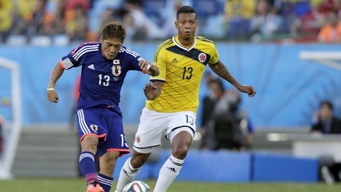 Colombia tops World Cup group by beating Japan 4-1