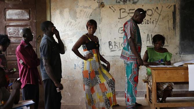 Voters queue to cast their ballots in the second round of presidential election and the fourth district of Bangui, Central African Republic, Sunday, Feb. 14, 2016. Two former prime ministers, Faustin Archange Touadera and Anicet Georges Dologuele, are running neck-and-neck in the second round of presidential elections to end years of violence pitting Muslims against Christians in the Central African Republic. Central Africans will also vote in Legislative elections. (AP Photo/Jerome Delay)