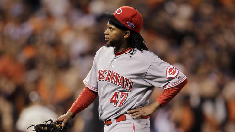 1st Cincinnati Reds starting pitcher Johnny Cueto heads to the dugout after pitching in the first inning of Game 1 of the National League division baseball series against the San Francisco Giants in San Francisco, Saturday, Oct. 6, 2012. Cueto left the game with an injury. (AP Photo/Eric Risberg)