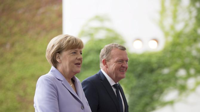 German Chancellor Angela Merkel welcomes Danish PM Rasmussen for talks at the chancellery in Berlin
