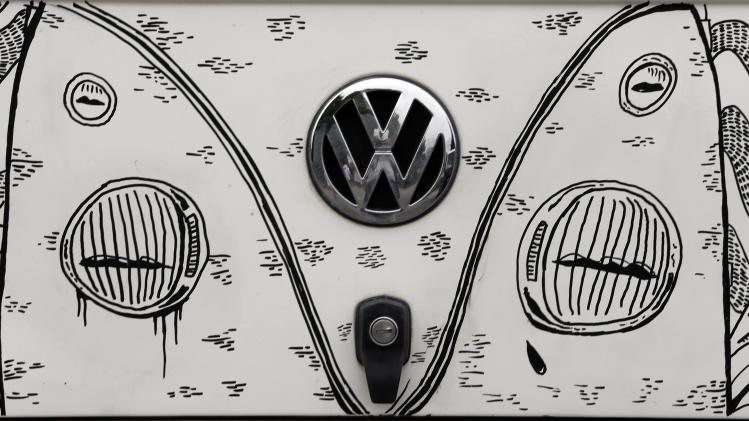 The Volkswagen logo is seen on a customized Kombi minibus during a Kombi fan club meeting in Sao Bernardo do Campo