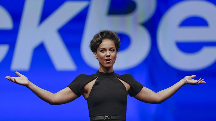 Entertainer Alicia Keys, Global Creative Director for BlackBerry speaks at a conference, Tuesday, May 14, 2013, in Orlando, Fla. (AP Photo/John Raoux)
