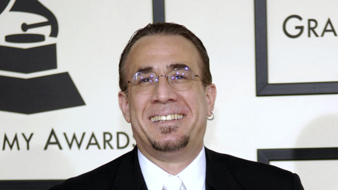 FILE - In this Feb. 10, 2008 file photo, jazz musician Bobby Sanabria arrives at the 50th Annual Grammy Awards in Los Angeles. A lawsuit filed against the Recording Academy over its decision to trim the Grammy categories from 109 to 78 has been dismissed by a judge. The motion last week by New York State Supreme Court Justice Jeffrey Oing granted the academy's motion to reject a lawsuit brought by Grammy-nominated jazz musician Bobby Sanabria and three others. Sanabria had been the loudest opponent of the academy's decision last year to reduce its categories and fold some genres into larger fields. (AP Photo/Chris Pizzello, file)
