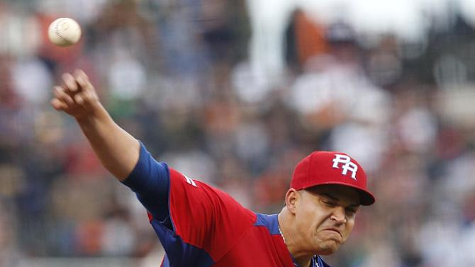 Puerto Rico's Mario Santiago pitches during the first inning of a semifinal game of the World Baseball Classic against Japan in San Francisco, Sunday, March 17, 2013. (AP Photo/Stephen Lam, Pool)