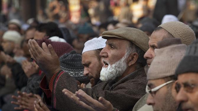 Kashmiri Muslims pray outside the Shrine of Sufi saint Khwaja Naqashbandi in Srinagar, India, Friday, Dec. 26, 2014. Thousands of Kashmiri Muslims congregated at the shrine on the death anniversary of the saint and offered prayers in a three-day festival that concluded Friday. (AP Photo/Dar Yasin)