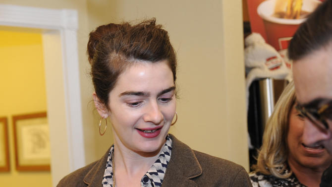 Actress Gaby Hoffmann tries on Park Lane jewelry at the Fender Music lodge during the Sundance Film Festival on Friday, Jan. 18, 2013, in Park City, Utah. (Photo by Jack Dempsey/Invision for Fender/AP Images)