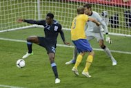 English forward Danny Welbeck (L) flicks the ball with his heel to score past Swedish goalkeeper Andreas Isaksson during the Euro 2012 group match on June 15 at the Olympic Stadium in Kiev