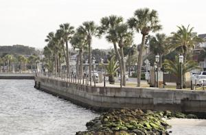 In this Tuesday, Feb. 3, 2015 photo a sea wall separating …
