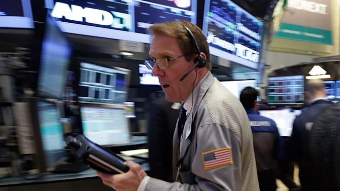 Trader Luke Scanlon rushes across the floor of the New York Stock Exchange Monday, March 25, 2013.  U.S. stock markets are opening higher after Cyprus clinched a last-minute bailout that saved it from bankruptcy. (AP Photo/Richard Drew)