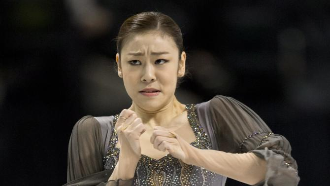 Kim Yu-na, South Korea, performs her free program in the women's competition at the World Figure Skating Championships Saturday, March 16, 2013 in London, Ontario. (AP Photo/The Canadian Press, Paul Chiasson)