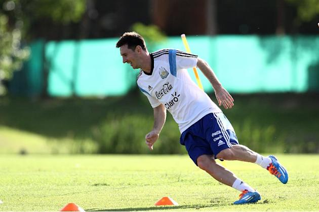 In this picture released by Argentina's Soccer Federation, Lionel Messi trains at Argentina's training facilities in the outskirts of Buenos Aires, Thursday, Dec. 5, 2013. Messi is in Argentin