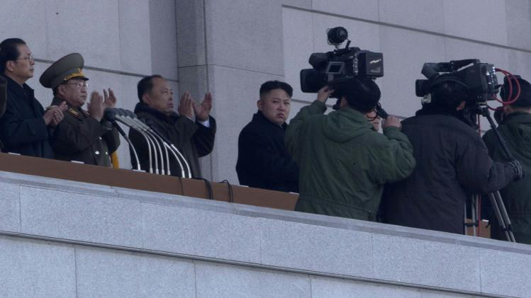 North Korean leader Kim Jong Un, top center, attends a ceremony to reopen the Kumsusan Palace of the Sun in Pyongyang, North Korea,  Monday, Dec. 17, 2012. North Korean officials reopened the mausoleum on the first anniversary of the death of his father and nation's leader Kim Jong Il. (AP Photo/Ng Han Guan)