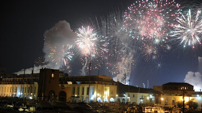 Fireworks light over a port as Algeria marks 50 years of independence in Algiers, early Thursday, July 5, 2012. As the Muslim North African nation celebrates 50 years of nationhood on Thursday, Algeria and France are locked in a  war of memories that still weighs on lives on both sides of the Mediterranean, and on the two countries' ties. (AP Photo/Anis Belghoul)