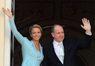 Prince Albert II and Princess Charlene of Monaco greet well-wishers from the balcony after their civil wedding at the Prince&#39;s Palace