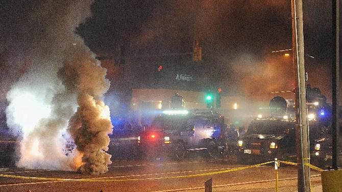 Law enforcement fires tear gas on protesters in Ferguson, Missouri on August 18, 2014