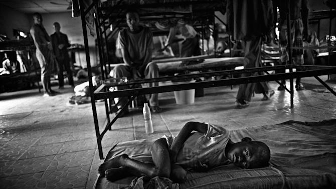 IMAGE DISTRIBUTED ON BEHALF OF THE SONY WORLD PHOTOGRAPHY AWARDS - A young mentally impaired boy sleeps on the floor in a room for high risk male inmates at a Rehabilitation facility outside Port Harcourt, in the Niger Delta, Nigeria, on Tuesday, Oct. 16, 2012. In 1999 this facility was turned into a place of incarceration for homeless people with mental illness that were cleared off the streets in a clean-up in anticipation of the FIFA World Youth Soccer Championship. They have been here ever since. This photo has been shortlisted for a Sony World Photography Award. The winners will be announced on April 25, 2013. (Robin Hammond/Panos/Sony World Photography Awards via AP Images)