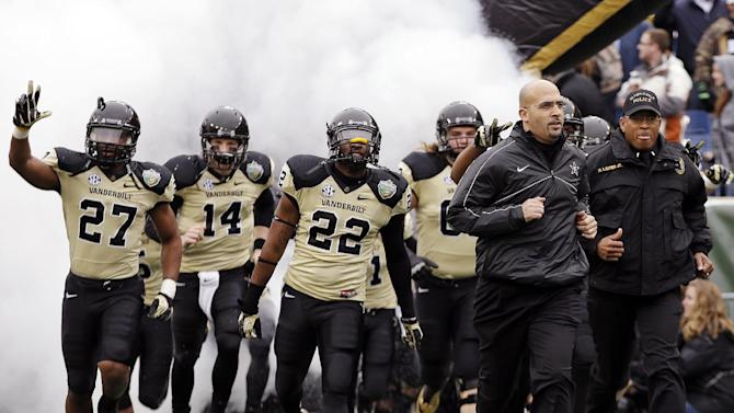 Vanderbilt head coach James Franklin, second from right, leads his team onto the field for the Music City Bowl NCAA college football game against North Carolina State, Monday, Dec. 31, 2012, in Nashville, Tenn. (AP Photo/Mark Humphrey)