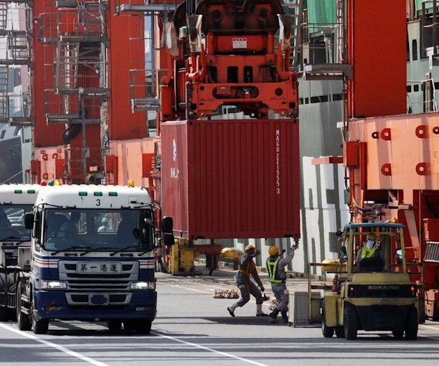 Containers are unloaded at the international cargo terminal in Tokyo, on May 22, 2013
