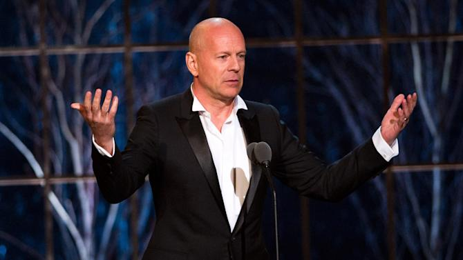 """FILE - In this March 26, 2011 photo, Bruce Willis appears onstage at the """"The Comedy Awards"""" presented by Comedy Central in New York.  Willis says he's willing to give away his popular central Idaho ski resort to a nonprofit.  The action star has already put his lavish home in nearby Hailey, Idaho, on the real estate market, it's listed at $15 million, along with his local bar and nightclub, The Mint, listed at about $4 million.  (AP Photo/Charles Sykes)"""