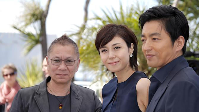 From left, director Takashi Miike, actors Nanako Matsushima and Takao Osawa pose during a photo call for the film Shield of Straw at the 66th international film festival, in Cannes, southern France, Monday, May 20, 2013. (AP Photo/Francois Mori)