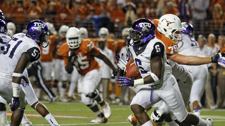 TCU safety Elisha Olabode (6) runs after intercepting a Texas pass during the first half of an NCAA college football game on Thursday, Nov. 22, 2012, in Austin, Texas. (AP Photo/Jack Plunkett)