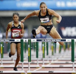 Lolo Jones clears a hurdle in front of Kori Carter during a women's 100m hurdles preliminary at the U.S. Olympic Track and Field Trials Friday, June 22, 2012, in Eugene, Ore. (AP Photo/Eric Gay)