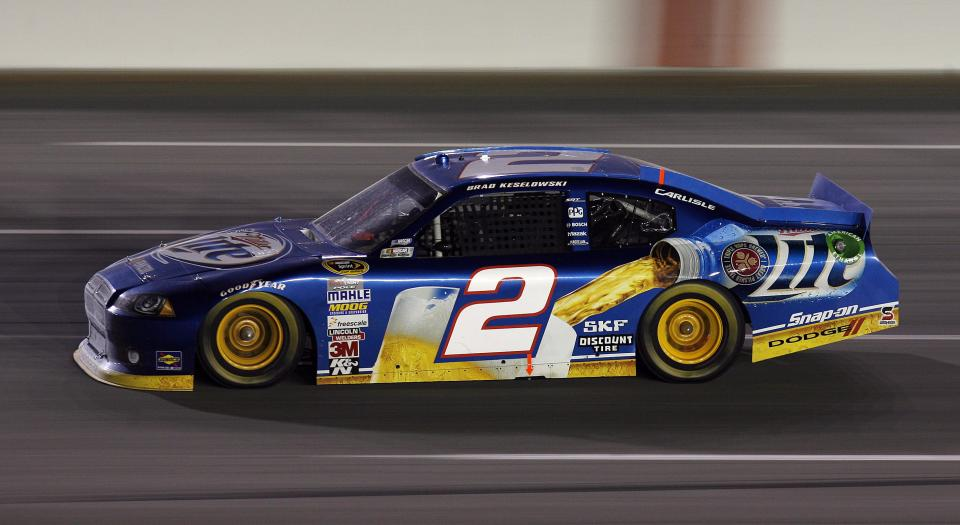 Brad Keselowski leads in the late laps on his way to winning the NASCAR Sprint Cup Series auto race at Kentucky Speedway in Sparta, Ky., Saturday, June 30, 2012. (AP Photo/James Crisp)