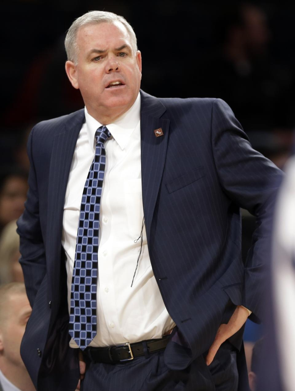 Brigham Young head coach Dave Rose calls out to his team during the first half of an NIT semifinal basketball game against Baylor on Tuesday, April 2, 2013, in New York. (AP Photo/Frank Franklin)