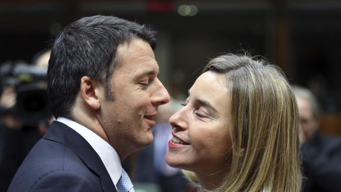 Italy's PM Renzi greets EU foreign policy chief Mogherini during a EU leaders summit in Brussels