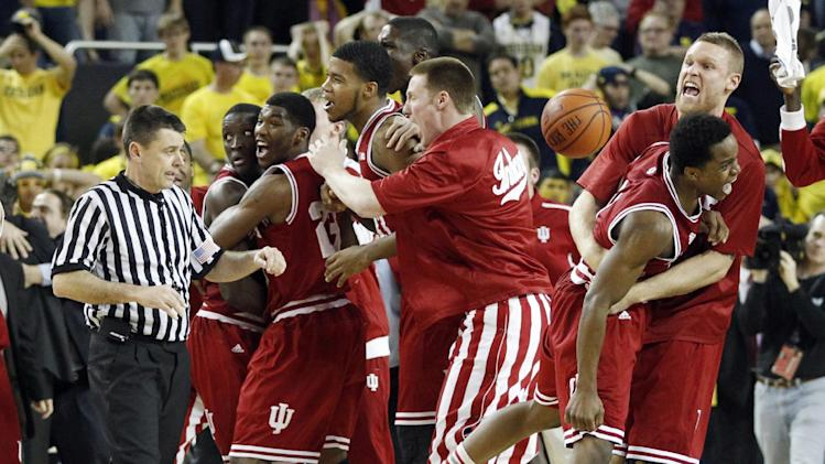 Indiana forward Derek Elston, right, hugs guard Kevin Ferrell after Indiana's 72-71 win over Michigan to capture the Big 10 title during an NCAA college basketball game Sunday, March 10, 2013, in Ann Arbor, Mich. (AP Photo/Duane Burleson)